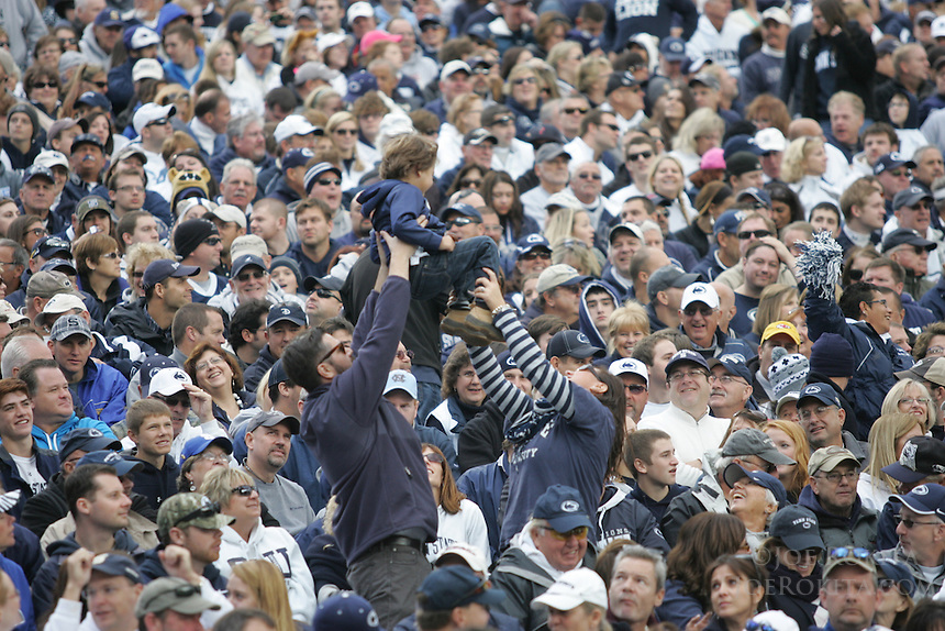 """State College, PA - 11/02/2013:  A young fan celebrates a PSU score by being """"tossed"""" in the stands.  Penn State defeated Illinois by a score of 24-17 in overtime on Saturday, November 2, 2013, at Beaver Stadium.<br /> <br /> Photos by Joe Rokita / JoeRokita.com"""
