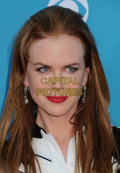 NICOLE KIDMAN .Arrivals - 45th Annual Academy Of Country Music Awards held at the MGM Grand Garden Arena, Las Vegas, NV, USA, 18th April 2010..ACM ACMs portrait headshot red lipstick make-up black bib front white shirt buttons collar earrings dangly  .CAP/ADM/BP.©Byron Purvis/AdMedia/Capital Pictures.