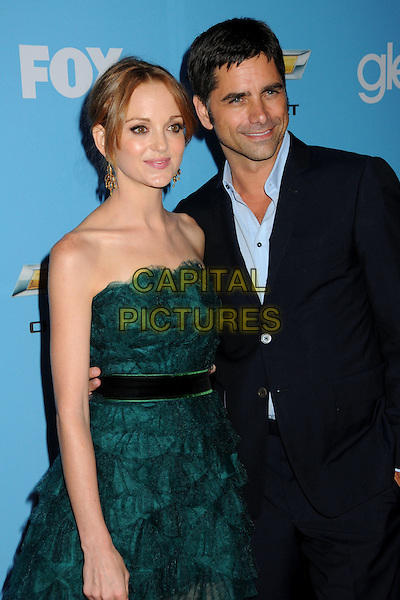 "JAYMA MAYS & JOHN STAMOS .""Glee"" Season Two Premiere and DVD Release Party held at Paramount Studios,  Los Angeles, California, USA, 7th September 2010 .half length green strapless dress ruffles tiered ruffle blue navy shirt suit arm around .CAP/ADM/BP.©Byron Purvis/AdMedia/Capital Pictures."