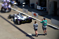 Verizon IndyCar Series<br /> Indianapolis 500 Practice<br /> Indianapolis Motor Speedway, Indianapolis, IN USA<br /> Tuesday 16 May 2017<br /> A fan takes a picture of Zach Veach's car in Gasoline Alley.<br /> World Copyright: F. Peirce Williams