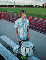 Eight grader Kade Kleymann (cq) plays the drum with the marching band during an eight man football game in Tribune, Kansas, Friday, October 13, 2013. The challenges of depopulation in the rural Midwest and Great Plains continue to grow as counties increasingly see more deaths than births. Greeley County, Kansas's least populated county, and the state as a whole are mounting a new fight to stem losses and finding early success. <br /> <br /> Photo by Matt Nager
