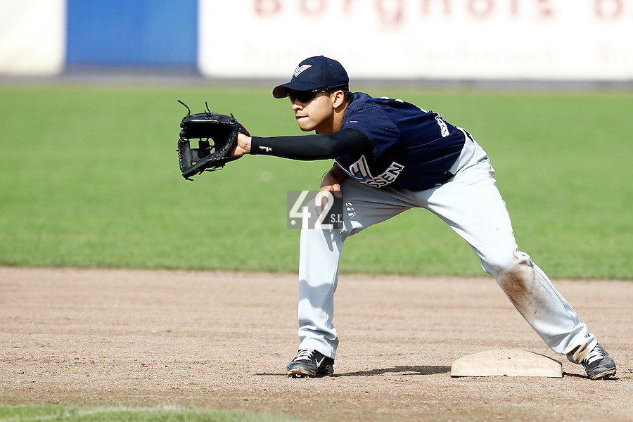 10 September 2011: Zerzinho Croes of Vaessen Pioniers eyes the ball during game 4 of the 2011 Holland Series won 6-2 by L&D Amsterdam Pirates over Vaessen Pioniers, in Amsterdam, Netherlands.