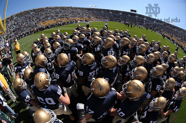 The football team gathers in the end zone before the Stanford game, 2008.