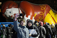 NEW YORK, NY – NOVEMBER 21: A couple takes a selfie with the McDonald's balloon while they visit the balloons of the annual Macy's Thanksgiving Day Parade the night before the parade on November 21, 2018 in New York City. (Photo by Pablo Monsalve /VIEWPress)