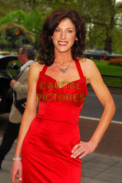 JULIETTE POCHIN.Arrivals at the Sony Radio Academy Awards 2006 at Grosvenor House Hotel, London, UK..May 8th, 2006.Ref: CAN.half length red dress satin.www.capitalpictures.com.sales@capitalpictures.com.© Capital Pictures.