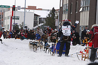 Saturday March 6 , 2010   Warren Palfrey on Cordova street turn during the ceremonial start of the 2010 Iditarod in Anchorage , Alaska
