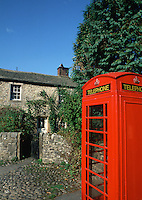 A traditional British red telephone box in a Yorkshire village. England.