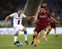 Football Soccer: UEFA Champions League  AS Roma vs PFC CSKA Mosca Stadio Olimpico Rome, Italy, October 23, 2018. <br /> CSKA Mosca's Fedor Chalov (l) in action with Roma's Kostas Manolas (r) during the Uefa Champions League football soccer match between AS Roma and PFC CSKA Mosca at Rome's Olympic stadium, October 23, 2018.<br /> UPDATE IMAGES PRESS/Isabella Bonotto