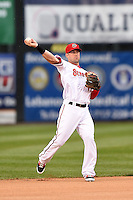 Harrisburg Senators shortstop Jason Martinson (11) warmup throw to first during a game against the New Britain Rock Cats on April 28, 2014 at Metro Bank Park in Harrisburg, Pennsylvania.  Harrisburg defeated New Britain 9-0.  (Mike Janes/Four Seam Images)
