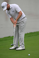 Branden Grace (RSA) putts on the 9th green during Thursday's Round 1 of the 2014 BMW Masters held at Lake Malaren, Shanghai, China 30th October 2014.<br /> Picture: Eoin Clarke www.golffile.ie