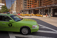 One of the new outer borough taxis is seen on the streets of in Greenwich Village in New York on Tuesday, August 27, 2013. The new breed of cabs can only pick up street hails in the outer boroughs and in Manhattan north of East 96th Street and West 110th Street. They can take passengers anywhere in the city and the Taxi and Limousine Commission will be issuing a total of 18,000 permits over three years.  (© Richard B. Levine)