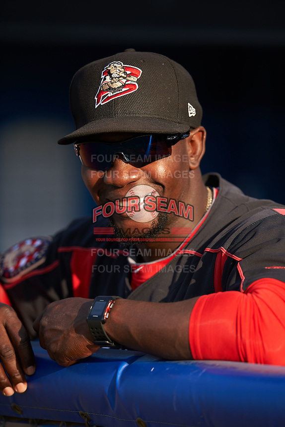 Batavia Muckdogs hitting coach Rigoberto Silverio (18) in the dugout before a game against the Auburn Doubledays July 10, 2015 at Dwyer Stadium in Batavia, New York.  Auburn defeated Batavia 13-1.  (Mike Janes/Four Seam Images)