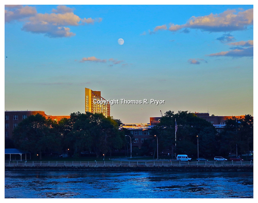 NEW YORK, NY - AUGUST 29: Full moon over the East River from Carl Schurz Park in Yorkville on the Upper East Side of New York, New York on August 29, 2012. Photo Credit: Thomas R. Pryor