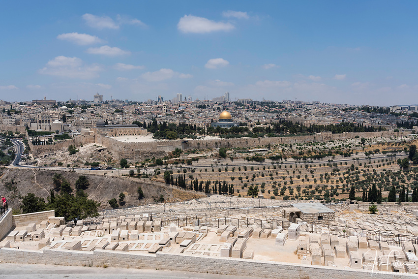 The al-Aqsa Mosque and Dome of the Rock shrine on the Temple Mount or al-Haram ash-Sharif in the Old City of Jerusalem, across the Kidron Valley as seen from the Mount of Olives.  The Christian Quarter of the Old City is to the left of the dome with the Muslim Quarter to its right.   The Old City of Jerusalem and its Walls is a UNESCO World Heritage Site.  At  right is the East Gate or Golden Gate  in the old wall with a Muslim cemetery in front of it.  In the foreground is the Jewish cemetery on the Mount of Olives.