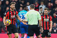 Simon Francis of AFC Bournemouth has words with Referee Kevin Friend  during AFC Bournemouth vs Arsenal, Premier League Football at the Vitality Stadium on 14th January 2018