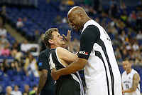 Mike Bushell BBC Sports Presenter (left) and Shawn Jamison retired Pro Basketball Player enjoy a laugh during Hoops Aid 2015 Celebrity AllStars Basketball Match at the o2 Arena, London, England on 10 May 2015. Photo by Andy Rowland.