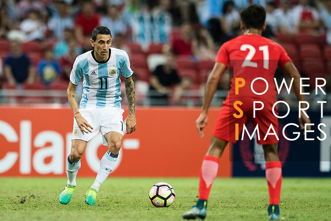 Angel Di Maria of Argentina (L) in action during the International Test match between Argentina and Singapore at National Stadium on June 13, 2017 in Singapore. Photo by Marcio Rodrigo Machado / Power Sport Images