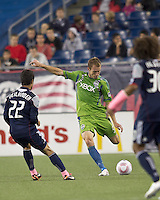 Seattle Sounders defender Tyson Wahl (5) passes the ball. In a Major League Soccer (MLS) match, the Seattle Sounders FC defeated the New England Revolution, 2-1, at Gillette Stadium on October 1, 2011.