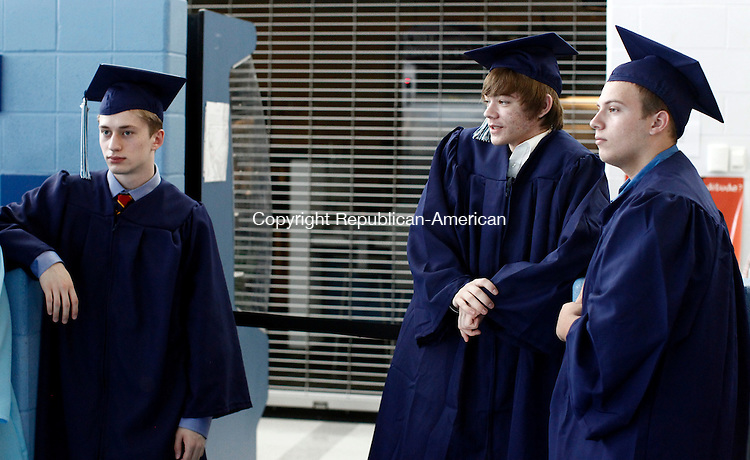 Oxford, CT- 17 June 2014-061714CM01-  Oxford High School graduates, left to right, Chris Gee, Pat Cragan and Jared Blakeman wait before the start of commencement exercises at Oxford High School on Tuesday.    Christopher Massa Republican-American