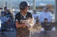 NWA Democrat-Gazette/BEN GOFF @NWABENGOFF<br /> Morgan Nelson of Bentonville dusts herself off after sliding in to score against Bentonville West Tuesday, April 10, 2018, during the game at Bentonville West's Wolverine Athletic Complex in Centerton.