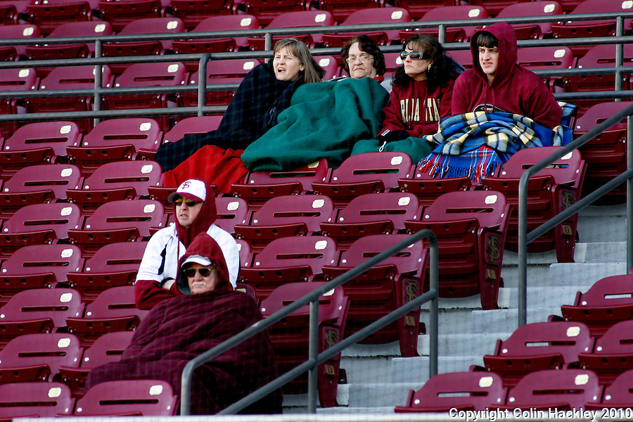 TALLAHASSEE, FL 2/13/10-FSU-BSB FANDAY10 CH42-Florida State's fans huddle under blankest during Fan Day Scrimmage action Saturday in Tallahassee...COLIN HACKLEY PHOTO