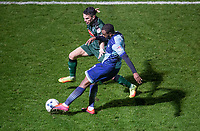 Myles Weston of Wycombe Wanderers prepares to cross the ball under pressure from Gary Miller of Plymouth Argyle during the Sky Bet League 2 match between Wycombe Wanderers and Plymouth Argyle at Adams Park, High Wycombe, England on 14 March 2017. Photo by Andy Rowland / PRiME Media Images.