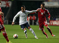 Pictured L-R: Tom Ince of England against Tom O'Sullivan of Wales.  Monday 19 May 2014<br />