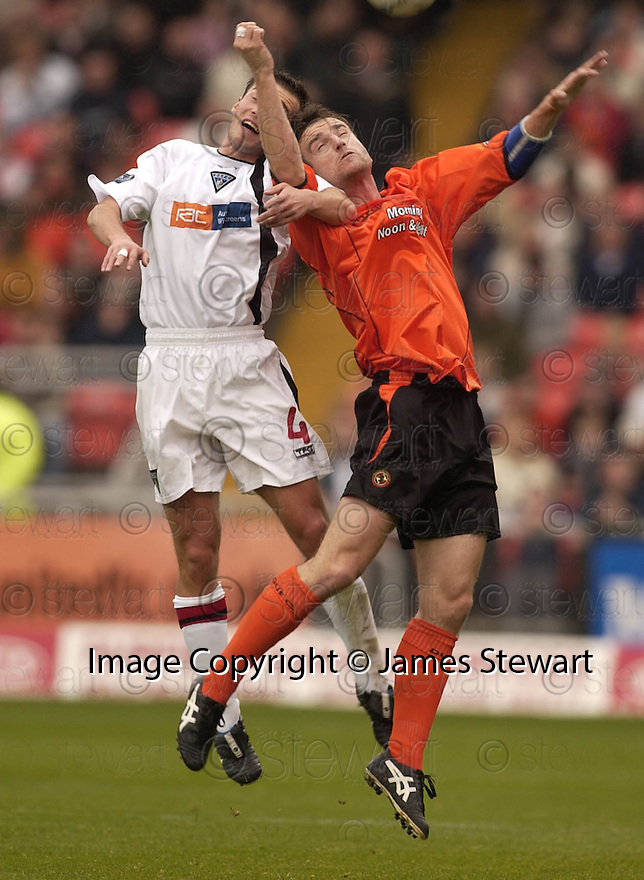 30/10/2004  Copyright Pic : James Stewart.File Name : jspa18_dundee utd v dunfermline.DARREN YOUNG AND GRANT BBREBNER GO FOR THE HIGH BALL.....Payments to :.James Stewart Photo Agency 19 Carronlea Drive, Falkirk. FK2 8DN      Vat Reg No. 607 6932 25.Office     : +44 (0)1324 570906     .Mobile  : +44 (0)7721 416997.Fax         :  +44 (0)1324 570906.E-mail  :  jim@jspa.co.uk.If you require further information then contact Jim Stewart on any of the numbers above.........