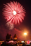 NAUGATUCK, CT 04 July 2005 -070405BZ04- From left- Naugatuck residents Ashley DeJesus, 15, Cindy DeJesus, 14, and their aunt Linda Miranda, 32, watch the annual fireworks display from the roof of a car in the Mountain View Plaza in Naugatuck Monday night.<br /> Jamison C. Bazinet Photo