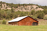Red wooden barn at the Double RL ranch in the San Juan Mountains of Colorado.