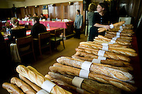 "Baguettes competing for the title of Best Baguette in Paris are lined up before the jury (L) gathers in Paris, France, 5 January 2004. 120 bakers competed in the 2004 edition of the prestigious annual Grand Prix de la Baguette. The title went to Pierre Thilloux from ""La Fournée d?Augustine"" bakery in the 14th arrondissement of Paris."