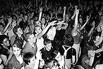 Skinheads in Camden Town at The Electric Ballroom, dancing to UB40 band. London 1980s. Jimmy John, skinhead centre middle giving the Nazi salute, they were what was then called 'Sieg Heiling'.  <br />