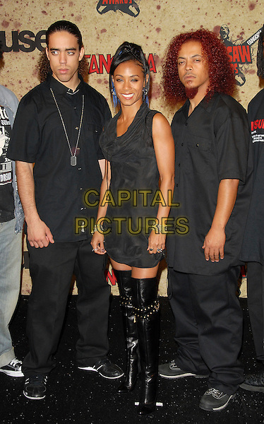 JADA PINKETT SMITH of Wicked Wisdom.attends The Fuse Fangoria Chainsaw Awards held at The Orpheum Theatre in Downtown Los Angeles, California, USA, October 15th 2006..full length knee high black boots  grey dress.Ref: DVS.www.capitalpictures.com.sales@capitalpictures.com.©Debbie VanStory/Capital Pictures