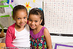Preschool ages 3-5 closeup portrait of two girls friends horizontal