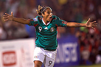 Maribel Dominguez of Mexico celebrates her goal during the semifinal match of CONCACAF Women's World Cup Qualifying tournament held at Estadio Quintana Roo in Cancun, Mexico. Mexico 2, USA 1.