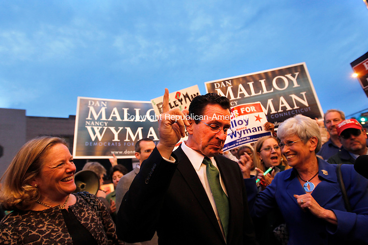 Torrington, CT- 25, October 2010-102510CM03 Democratic Governor candidate Dan Malloy, fires up supporters in downtown Torrington Monday night before a gubernatorial debate against Republican challenger, Tom Foley.   Christopher Massa Republican-American