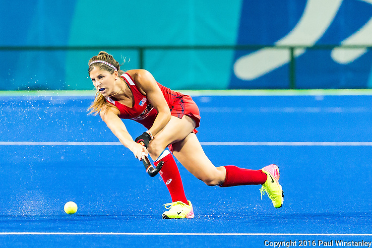 Katie Reinprecht #14 of United States passes during USA vs Japan in a Pool B game at the Rio 2016 Olympics at the Olympic Hockey Centre in Rio de Janeiro, Brazil.