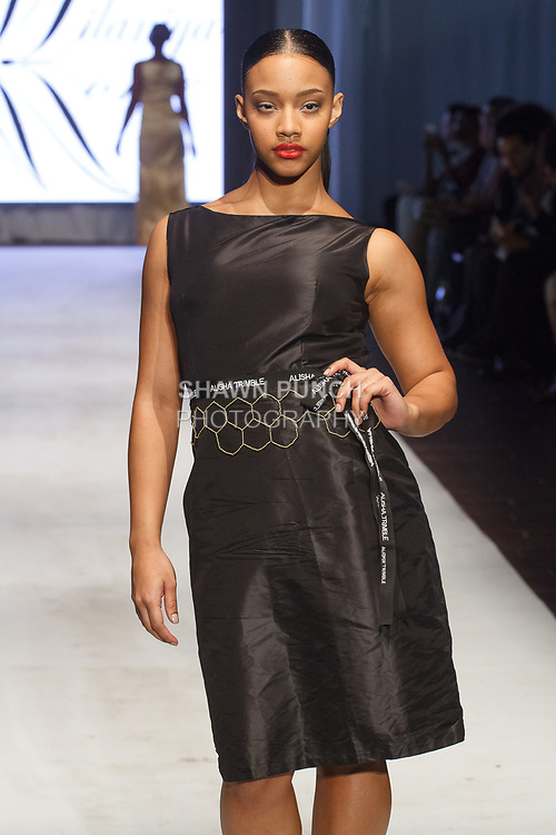 Model walk runway in an outfit from the Alisha Trimble Fall Winter 2017 collection fashion show, at the Brooklyn EXPO Center on April 1, 2017 during Fashion Week Brooklyn Fall Winter 2017.