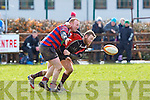 Matthew Ahern Castleisland tries to break the Killarney defence line during their league game in Castleisland on Sunday