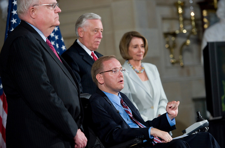 UNITED STATES - JULY 26:  From left, Rep. Jim Sensenbrenner, R-Wisc., House Majority Leader Steny Hoyer, D-Md., Rep. Jim Langevin, D-R.I., and Speaker Nancy Pelosi, D-Calif., attend a reception in Statuary Hall to mark the 20th anniversary of the Americans with Disabilities Act, as look on, July 26, 2010.  Afterwards Langevin presided over the House of Representatives made possible by a wheelchair-accessible modification to the rostrum.(Photo By Tom Williams/Roll Call via Getty Images)