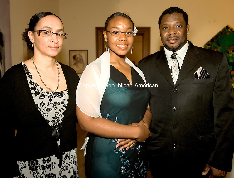 WATERBURY, CT--05 MAY 2007--050507JS13-Celebrate Girls award recipient Olivia Jones, center, with her parents Alma Jones, left, and Joeph Jones, right, during the Girls Incorporated of Greater Waterbury Celebrate Girls award dinner at the Mattatuck Museum Arts and History Center in Waterbury.  <br /> Jim Shannon/Republican-American