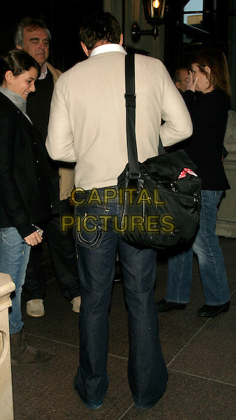 DENNIS QUAID.Celebrity Sighting at the Loews Regency Hotel, New York, NY, USA, .March 29, 2008 .full length back rear view behind black bag jeans pockets beige top jumper.CAP/LNC/TOM.©LNC/Capital Pictures