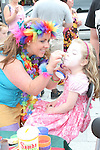 Issabelle Floyd has her face painted by Laughing Stock Entertainment at the Samba Festival on West Street...Photo NEWSFILE/Jenny Matthews.(Photo credit should read Jenny Matthews/NEWSFILE)....This Picture has been sent you under the condtions enclosed by:.Newsfile Ltd..The Studio,.Millmount Abbey,.Drogheda,.Co Meath..Ireland..Tel: +353(0)41-9871240.Fax: +353(0)41-9871260.GSM: +353(0)86-2500958.email: pictures@newsfile.ie.www.newsfile.ie.FTP: 193.120.102.198.