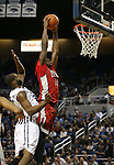 UNLV's Goodluck Okonoboh (11) dunks over Nevada defender Ronnie Stevens (33) during a college basketball game in Reno, Nev., on Tuesday, Jan. 27, 2015. The Rebels won 67-62. (Las Vegas Review-Journal/Cathleen Allison)