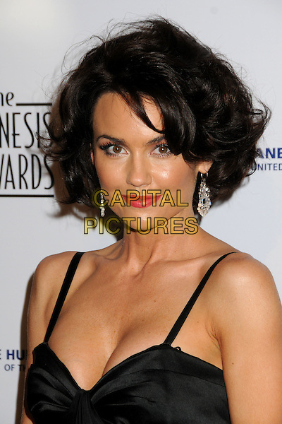 KELLY CARLSON .24th Annual Genesis Awards - Arrivals held at the Beverly Hilton Hotel, Beverly Hills, California, USA, 20th March 2010..portrait headshot black red lipstick make-up earrings dangly cleavage .CAP/ADM/BP.©Byron Purvis/AdMedia/Capital Pictures.
