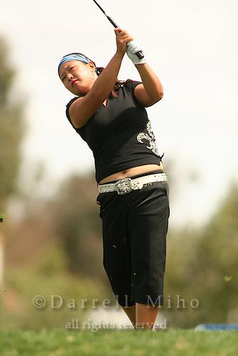 Apr. 1, 2006; Rancho Mirage, CA, USA; Christina Kim tees off on the 6th hole at the Kraft Nabisco Championships at Mission Hills Country Club. ..Mandatory Photo Credit: Darrell Miho.Copyright © 2006 Darrell Miho .