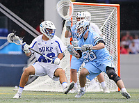 Annapolis, MD - May 20, 2018: Duke Blue Devils Reilly Walsh (42) spins away from a Johns Hopkins Blue Jays player during the quarterfinal game between Duke vs John Hopkins at  Navy-Marine Corps Memorial Stadium in Annapolis, MD.   (Photo by Elliott Brown/Media Images International)