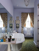 "The ""Mossy' carpet in the master bathroom is a classic John Fowler design"