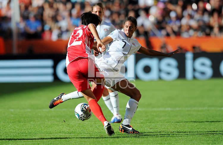 Shannon Boxx (r) of Team USA and Jon Myong Hwa of Team North Korea during the FIFA Women's World Cup at the FIFA Stadium in Dresden, Germany on June 28th, 2011.