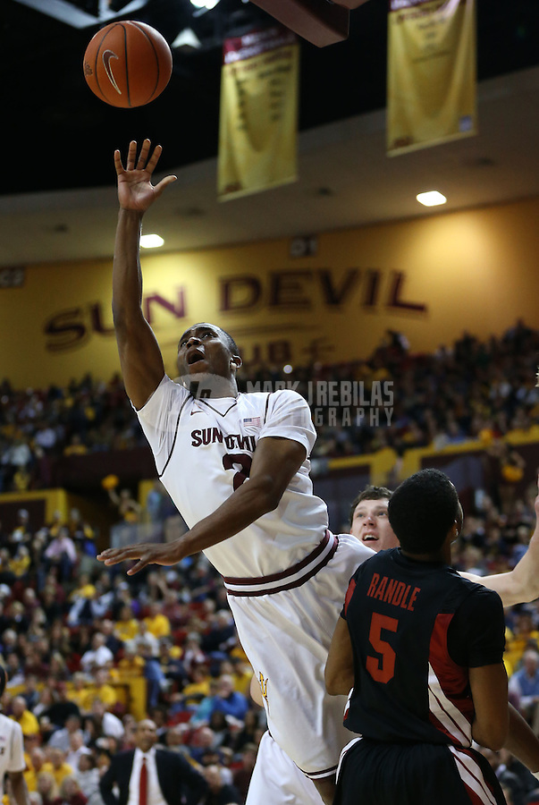 Feb. 9, 2013; Tempe, AZ, USA: Arizona State Sun Devils guard Chris Colvin (2) drives to the basket in the first half against the Stanford Cardinal at the Wells Fargo Arena. Mandatory Credit: Mark J. Rebilas-